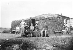 Early 1900s pioneer family dressed in their Sunday best up for the traveling photographer. The sod house is how pioneer families lived. Incredibly awful. Biddy Craft
