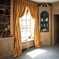 A Hallidays window seat with concealed radiator and Georgian style bookcase