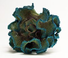 Beaded pseudosphere, with infant, by Sue Von Ohlsen, contributor of the Coral Reef project