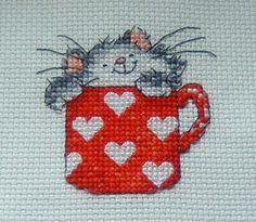 kitty in a mug