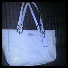 SALE!!Coach shoulder bag, off white patent leather Off white bag its been in my closet for a long time and I think the color got a little darker.  It has some scoffs at the bottom and some stains from rubbing against my clothes.  Price accordingly Coach Bags Shoulder Bags
