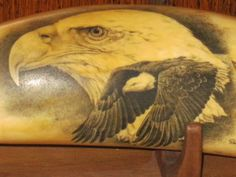 The art of scrimshaw by Darrel Morris, scratches filled with ink on ivory,America's first folk art, on a very old whales tooth.
