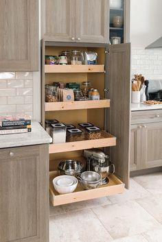 Look at this spacious cabinet with deep roll-out trays. It's just great for bulky appliances and large pantry canisters.