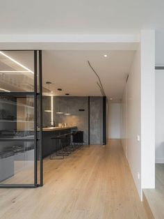 A Barcelona Penthouse Grounded in Natural Light and Black Accents - Design Milk | #kitchen #glasswalls