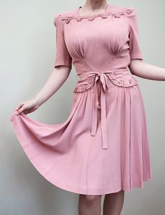 1940s dusty pink dress with stunning details. Side zip, rear neck zip, tie belt, unlined, beautiful detailing on chest and hip, flowing skirt.