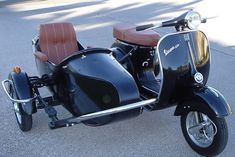 Vespa VBB con Sidecar For me and the Butterbean to cruise in around town.