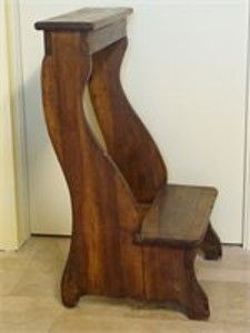 A 17th century molded walnut inginocchiatoio (prie-dieu or prayer kneeler ) built in  the Marche .