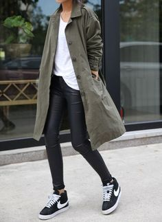 A dark green trenchcoat and black leather leggings are perfect for both running errands and a night out. Mix things up by wearing monochrome low top sneakers. Shop this look for $135: http://lookastic.com/women/looks/black-and-white-low-top-sneakers-black-leggings-dark-green-trenchcoat-white-crew-neck-t-shirt/5731 — Black and White Low Top Sneakers — Black Leather Leggings — Dark Green Trenchcoat — White Crew-neck T-shirt