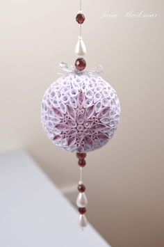 a foam ball, some beads, a little quilling...easy peasy right??? Well ok, not easy but freaking incredible looking!!!