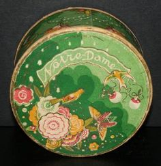 Notre Dame                     Type:Powder                    Material(s):Cardboard                    Designer/Maker:Nally                    Box Description:Decorated with flowers, birds and butterflies.                    Origin:Portugal                    Date or Era:1929