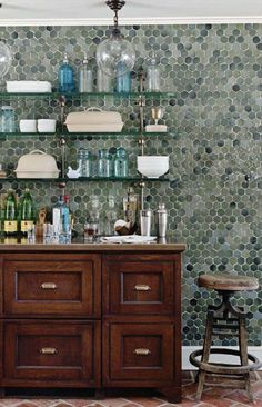 Cool hexagon tiled wall is a great backdrop for this open shelved bar