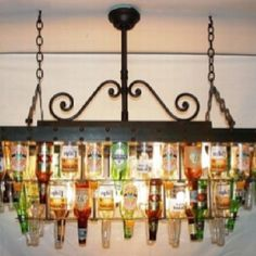 make a beer bottle chandelier - very crafty . mmmm, I dunno - I kind of like this idea for over my pool table. and maybe make another one out of champagne/wine bottles for the dining room. I (Champagne Bottle Chandelier) Beer Bottle Chandelier, Bottle Lamps, Bottle Candles, Bottle Lights, Casa Rock, Pool Table, Pool Bar, My Dream Home, Game Room