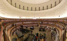 The Stadsbiblioteket (Stockholm Public Library main branch) bookshelves circling the rotunda, built 1924-1928, architect Gunnar Asplund, Sweden ... one of the first libraries to allow users direct access to the stacks without the help of a retrieving librarian