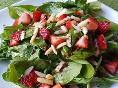 Cacao Nib Dressing Over Greens with Strawberries and Almond Slivers