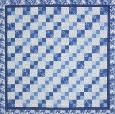 Create one-way movement by arranging Four-Patch units and setting squares in a diagonal Irish Chain pattern.