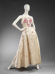 "Circa 1953 dress by Norman Hartnell, who wrote in his autobiography, ""I despise simplicity. It is the negation of all that is beautiful."""