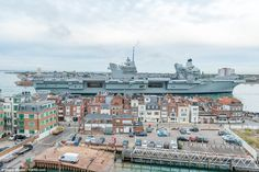 HMS Queen Elizabeth, the UK's newest aircraft carrier, has arrived in Portsmouth, as thousands of people line the seafront