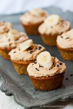 Nutella Swirled Banana Cupcakes. Moist Banana Cupcakes with Nutella swirled right into the center, topped with a creamy Peanut Butter frosting! #cupcakerecipes