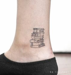Tattoo Artist: Be Lucchesi. Tags: categories, Blackwork, Illustrative, Line Art, Fine Line, Other, Books. Body parts: Ankle.
