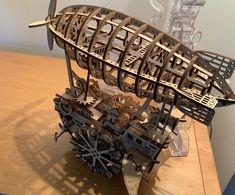 Puzzle en bois 3D Maquette DIY Puzzle mecanique Mecapuzzle DIY  Loisirs créatifs Idée cadeau Puzzle Spaceship, Puzzle, 3d, Ideas, Basket, Creative Crafts, Gift Ideas, Space Ship, Puzzles