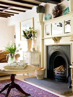 Living room fireplace. It looks spotless!  Little Emma English Home: Cottage style
