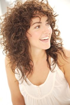 Nick Arrojo's Top Tips for Styling Curly Hair. (Picture of curly hair with bangs.)