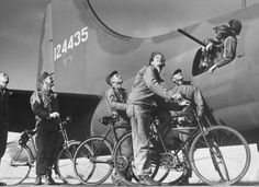 8Th Air Force Bomber Command. 8th Bomber Command, B-17 Flying Fortress ground crew on English bicycles bidding goodby to Fortress gunners before bomber takes off on raid in Europe, at airdrome in southern England. | Location: United Kingdom | Date: September 1942 | Photographer: Margaret Bourke-White | LIFE archive - Hosted by Google