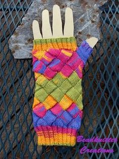 If you've been trying to find a knitting pattern for fingerless gloves that has a little bit of attitude, these Entrelac Rainbow Mitts are just what you need.