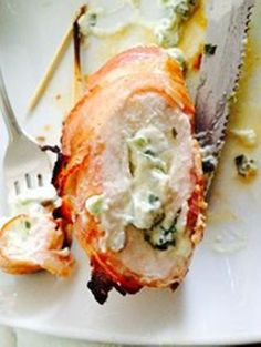 Chicken, Bacon and Cream Cheese - 2 chicken breasts flattened to 1/4 inch thickness, cream cheese mixed with sliced green onion. Spread cheese mix on chicken and roll up. Wrap 2 or 3 slices of raw bacon around each breast and secure with a toothpick. Bake @ 350 for 30 mins then broil for 5.