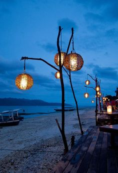 bar lanterns Could do this at the cottage. Sink the sticks in big planters full of sand and place on deck area. Sink the sticks in big planters full of sand and place on deck area. Backyard Lighting, Outdoor Lighting, Outdoor Decor, Lighting Ideas, Outdoor Seating, Modern Lighting, Outdoor Lamps, Beach Lighting, Outdoor Lantern