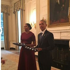 POTUS and FLOTUS receive the flags from the first and last day in the White House - a gift from the White House staff.