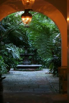 Cool, inviting courtyard in New Orleans. It's not just the lush greenery that makes courtyards so appealing, it's the way you get just a peek at them through an archway, gate, or portal. Hygge, Outdoor Spaces, Outdoor Living, New Orleans Architecture, Fresco, New Orleans French Quarter, New Orleans Louisiana, Garden Design, Courtyard Design