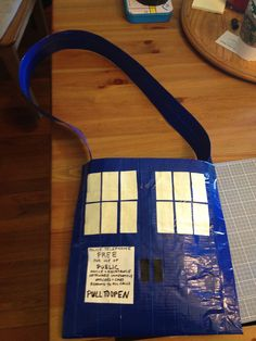 Why, yes, that is a hand-crafted TARDIS trick-or-treat bag made entirely of DUCT TAPE. The windows are glow-in-the-dark. Did you even know they made glow-in-thedark duct tape? Well, now you do. You're welcome.  #thinkgeekoween