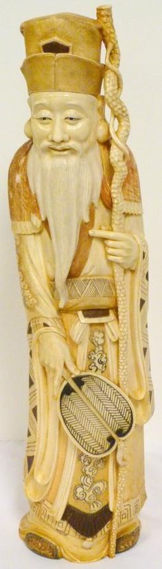 """LARGE JAPANESE IVORY POLYCHROMED WISE MAN FIGURE Very highly detailed polychromed Japanese ivory figure depicting a wise man with staff and fan. He is wearing layered robe with cloud and pattern designs. 19th/20th century. Signed to base. Measures 20 1/4"""" height"""