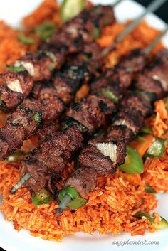 I miss this– though I never got beef in Gha… Ghanaian Jollof Rice & Beef Kebab. I miss this– though I never got beef in Ghana! Bring on the goat! Kebab Recipes, Indian Food Recipes, Beef Recipes, Cooking Recipes, Ethnic Recipes, African Recipes, Goat Recipes, Ghanaian Food, Nigerian Food