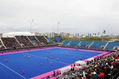 Riverbank Arena is a temporary stadium that will host the 2012 field hockey games. This will be the first time an Olympic field hockey turf is blue.