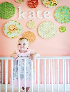 """We fell in love with this sweet DIY nursery wall art idea from Aedriel Originals. It's a unique and inexpensive way to add color and character to your child's new room (plus, how cute is baby Kate?). To add a personal touch, Aedriel suggests using fabric that has a story to tell. """"What about an embroidered hankie of your grandmother's, or a favorite dress you wore as a child?"""" she says. """"All the important women in your daughter's life could provide a fabric swatch."""" What You Need: 1…"""