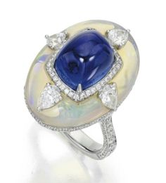 18k white gold,  opal, sapphire, and diamond ring.