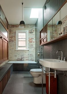 Amazing exposed brick bathroom