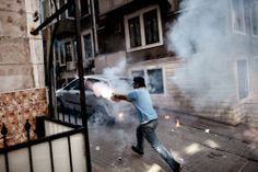 A protester launches fireworks during clashes against riot police in Taksim Square, on June 11, 2013