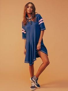 Sports Tee Dress | Ultra relaxed cotton dress featuring an asymmetrical neckline and hem with stripe details for a femme sporty feel.