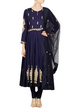 Featuring a midnight blue cotton georgette anarkali with gold dabka and cutdana embroidery on bodice. It has embroidered motifs on sleeves and around hem. It is paired with a matching net dupatta with dabka embroidered bootis. It comes along with a blue silk mulmul drawstring churidar by AMBRISH DAMANI Shop now-www.carmaonlineshop.com