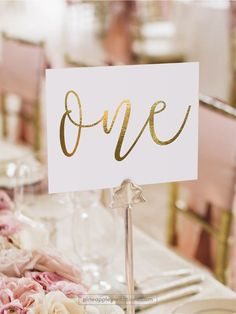 D E T A I L S ──────────────────── #TN101G - Two sided The Gold Foil Table Numbers are a perfect addition to your wedding reception tables! These table numbers are done with shiny Gold finish (real Gold Foil). All table numbers are printed on both sides on premium quality finished papers. Please note: Table holders / frames / flowers / accessories are not included. ○ Foil Colour – Gold ○ Card Format – Flat Card ○ Printing on Both Sides ○ Size – 4x6 - 102x153mm ○ Size – 5x7 ...