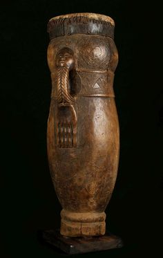 """""""A KUBA 'BULUP' DRUM, DEMOCRATIC REPUBLIC OF CONGO Of elongated cylindrical shape slightly tapering towards the base, the percussion surface covered in animal skin..."""" perhaps 19th c."""