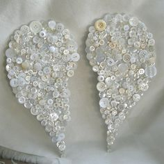 vintage button angel wings would be pretty on back of a shirt or jean jacket.