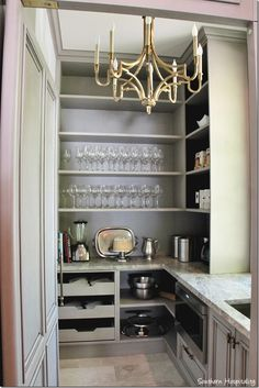 kitchen butlers pantry- nice layout and really like the paint color with the brass light