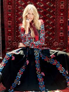 The model poses in bohemian luxe looks for the editorial