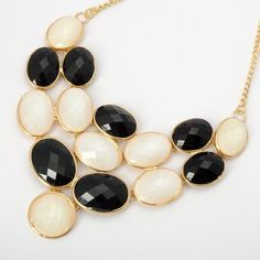 Fashion Golden Chain Jewelry Ellipse Black White Resin Pendant Necklace ComeOnBuying,http://www.amazon.com/dp/B009D8R2CO/ref=cm_sw_r_pi_dp_qrEttb12MM1E4MY2