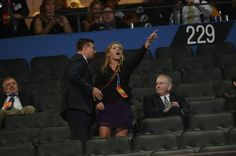 """""""A protester is led away while Rick Santorum speaks during the convention"""" -- The Washington Post"""