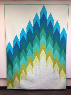 """Quilt made using the forthcoming """"Firelights Lane"""" pattern from Sassafrass Lane Designs. (Anyone know the artist/source?)"""